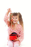 Little girl opens her present Royalty Free Stock Images