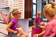 Little girl in optician shop Stock Photos