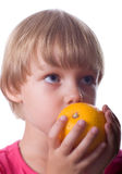 Little girl with orange Stock Photography