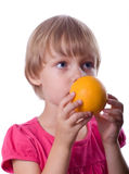 Little girl with orange Royalty Free Stock Photography