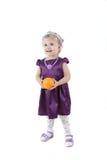 Little girl with orange Stock Image