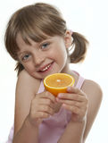Little girl with orange Royalty Free Stock Photos