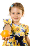 Little girl with orange. Royalty Free Stock Image