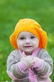 Little girl in an orange beret Stock Photo