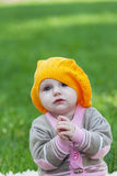 Little girl in an orange beret Stock Images