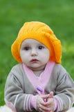Little girl in an orange beret Stock Photos