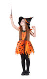 Little girl in orange costume of witch for Halloween. Holds up and looks at wand isolated on white background Royalty Free Stock Photo