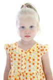 Little girl in orange dress Stock Photo