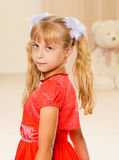 Little girl in orange dress Stock Image