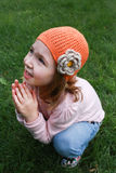 Little girl in orange hat and pink sweater Stock Photo