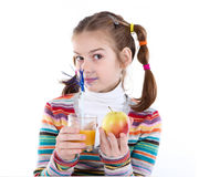 Little girl with orange juice Royalty Free Stock Photo