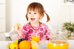 Little girl with orange juice Royalty Free Stock Image