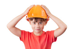 Little girl in the protective helmet. Little girl in the orange protective helmet Royalty Free Stock Photos