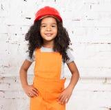 Little girl in orange repairmen uniform Royalty Free Stock Photos