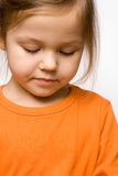 Little girl in orange shirt Royalty Free Stock Image