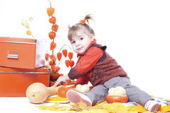 Little girl in an orange vest Royalty Free Stock Photo