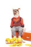 Little girl in an orange vest Royalty Free Stock Image