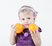 Little girl with oranges Stock Photo
