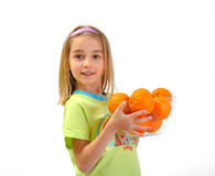 Little girl with oranges isolated on white Royalty Free Stock Image