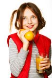 Little girl with oranges and juice. Isolated on white Royalty Free Stock Images