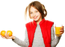 Little girl with oranges and juice. Isolated on white Royalty Free Stock Photography