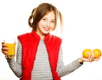 Little girl with oranges and juice. Isolated on white Stock Photography