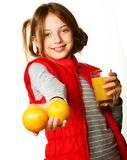 Little girl with oranges and juice Royalty Free Stock Image