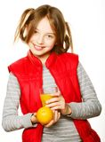 Little girl with oranges and juice. Isolated on white Stock Photo