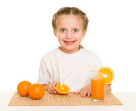 Little girl with oranges Royalty Free Stock Images