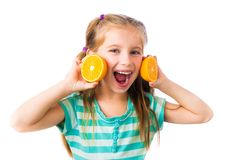 Little girl with oranges Royalty Free Stock Photo