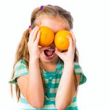 Little girl with oranges Royalty Free Stock Photos
