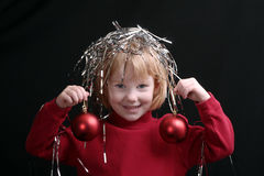 Little girl with ornaments stock photos