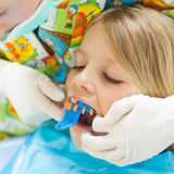 Little girl at the orthodontist Royalty Free Stock Photo