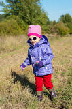 Little girl outdoor in the autumn Stock Photo