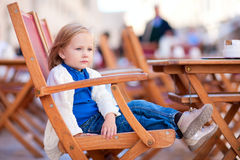 Little girl at outdoor cafe Royalty Free Stock Images