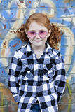 Little girl outdoor in front of painted wall Stock Image