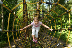 Little girl in outdoor park attractions Royalty Free Stock Images