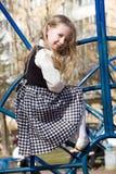 Little girl on outdoor playground. Fair-haired pretty little girl playing on outdoor playground Stock Photos