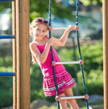 Little girl on outdoor playground Stock Photo