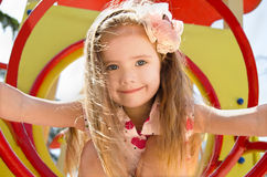 Little girl on outdoor playground equipment Royalty Free Stock Photos