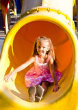 Little girl on outdoor playground equipment Royalty Free Stock Image