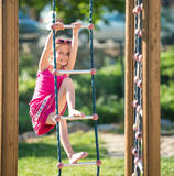 Little girl on outdoor playground Stock Images