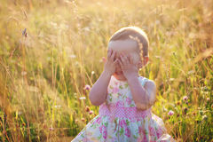 Little girl outdoors. Little girl playing outdoors at the sunset Stock Image