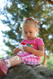 Little girl outdoors Stock Photography