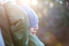 Little girl outdoors. Adorable little girl wearing warm clothes outdoors on beautiful winter morning Stock Photos