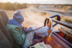 Little girl outdoors. Adorable little girl wearing warm clothes outdoors on beautiful winter morning safari game drive Stock Photos