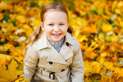 Little girl outdoors at autumn Stock Photography