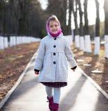 Little girl outdoors in autumn. Stock Image