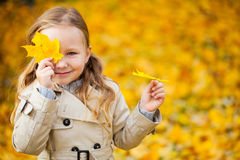 Little girl outdoors at autumn day Royalty Free Stock Image