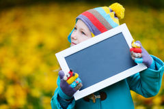 Little girl outdoors on autumn day Royalty Free Stock Photography